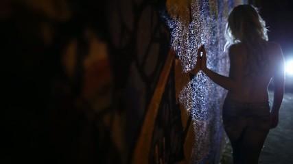 Girl and graffiti wall, up close