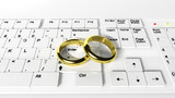 Wedding rings on the keyboard