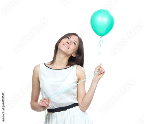 happy girl with green balloon as a present for birthda
