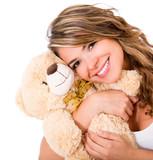 Cute woman with a teddy bear