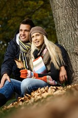 Young couple in park at autumn