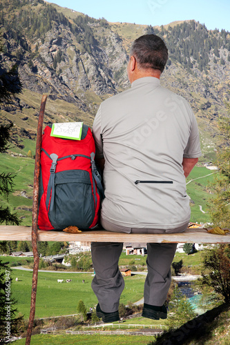 Man makes break from hiking and enjoying the view