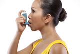 Girl With Blue Asthma Inhaler