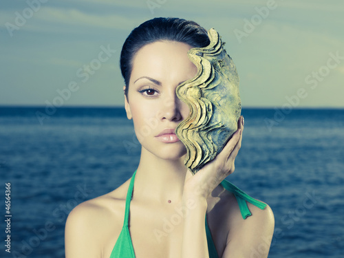 Beautiful lady with large sea shell