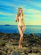 Leinwanddruck Bild - Gorgeous blonde in flower bikini at the sea