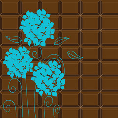 Blue hydrangea on the chocolate background