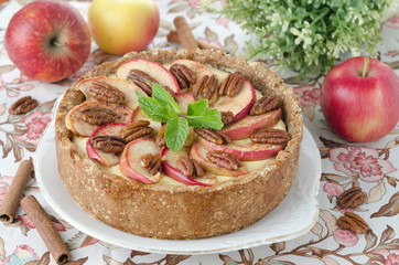 cheesecake with apples and caramelized pecans