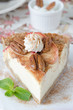 slice of cheesecake with apples and caramelized pecans closeup s