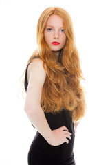 Fashion girl with long red hair against white background.