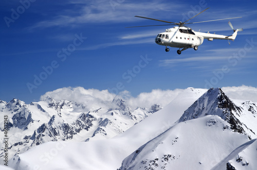 Foto op Canvas Helicopter Helicopter in winter mountains