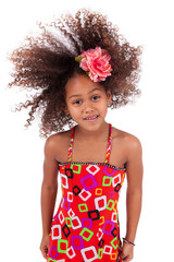 Cute young African Asian girl playing with her hairs