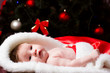 Newborn baby sleeping. Xmas team