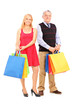 Mature man and woman holding shopping bags