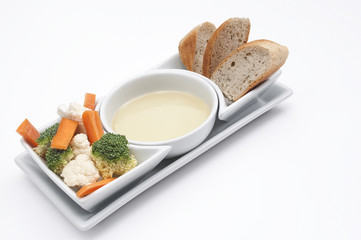 Fresh salad and bread with a dip