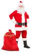 Santa Claus posing next to a bag