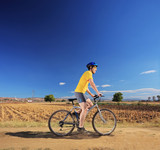 Male in yellow shirt riding a bike outdoor
