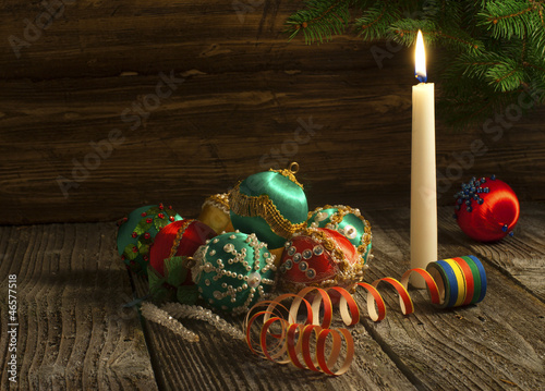 Vintage handmade Christmas decoration over wooden background
