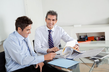 Mid Adult Businessman With Colleague In A Meeting