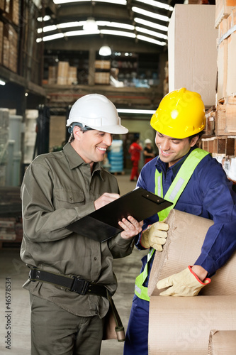 Supervisor Showing Clipboard To Foreman