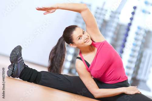 Woman doing stretching exercises at the gym