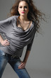 casual Girl in jeans full body isolated on gray background