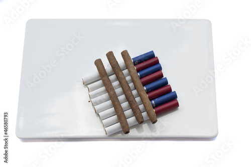 cigarette and cigarillo isolated on white