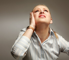 young woman suffering a migraine