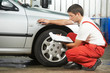 auto mechanic repairman inspecting car