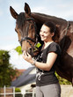 Dressage riding - woman proudly presents her horse outdoors