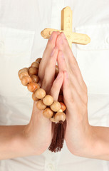 Hands in Prayer with Crucifix close-up