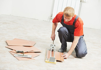tiler cutting tile at home renovation work