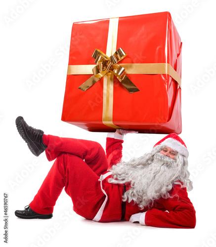 Santa Claus holding a big gift