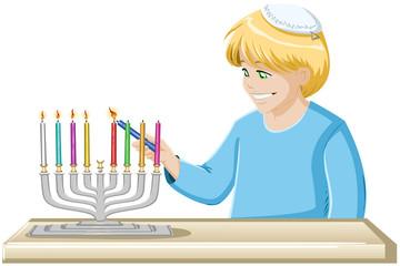 A Boy Lights A Hanukkiah Candle