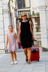 Touring Venice - woman and girl on the way to the hotel