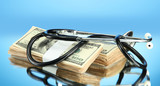 Healthcare cost concept: stethoscope and dollars