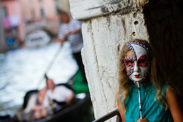 Carnival in Venice, Italy - lovely girl with carnival mask