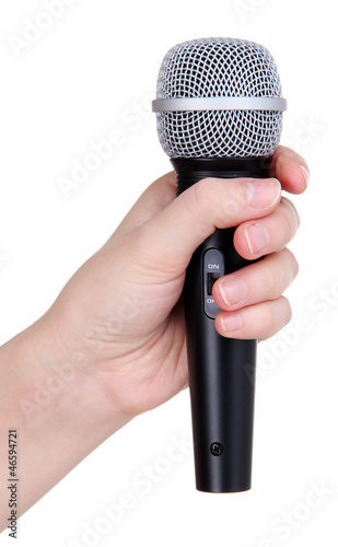 Black microphone in hand isolated on white