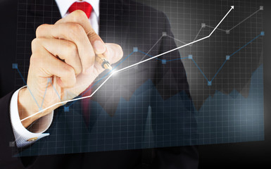 businessmen draw a graph