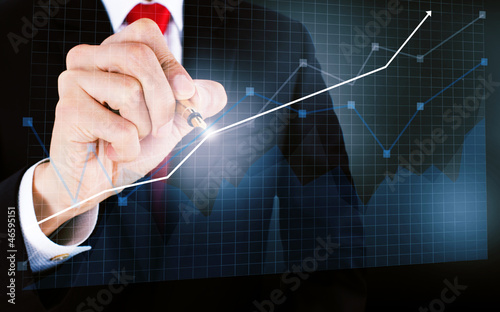 businessmen draw a graph