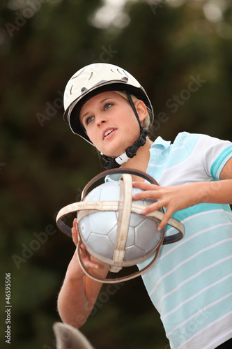 Girl playing Horseball