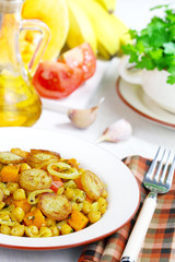 Pumpkin with chickpeas and fried bananas