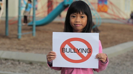 Cute Asian Girl With Large NO BULLYING sign