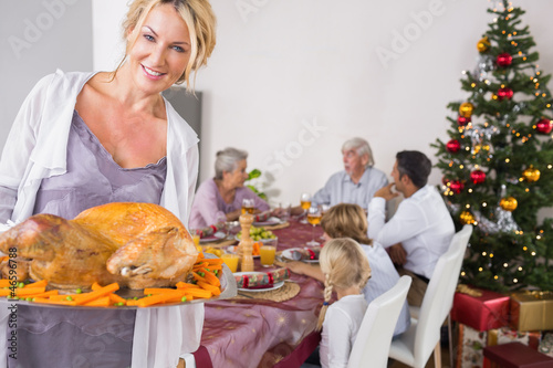 Proud mother showing roast turkey