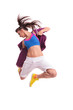 Modern young woman dancer jumping