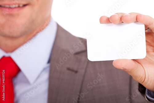 blurred man holding business card