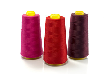 red pink and purple bobbin with thread