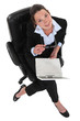 Businesswoman sat in office chair with laptop