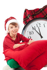 Baby in Santa Claus hat waiting for gift