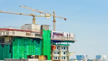 Crane and building working progress