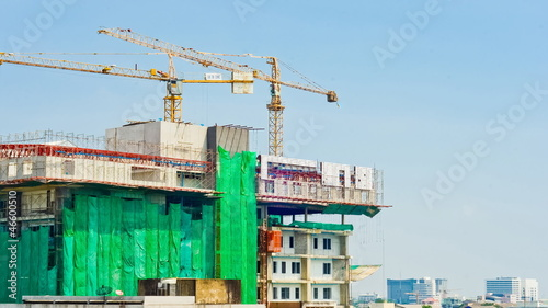 Crane and building working progress